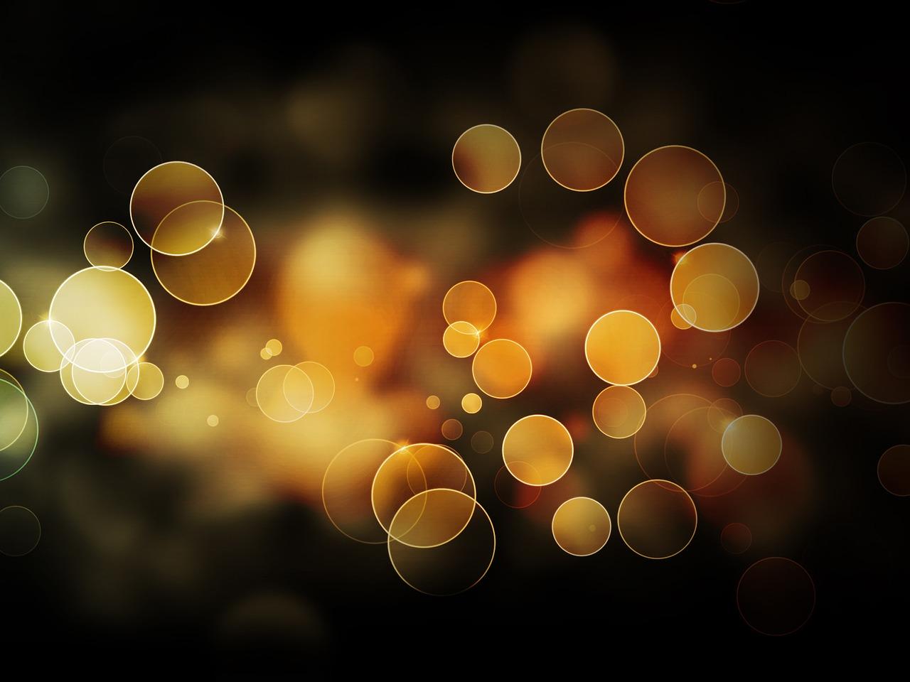 たくさんの金色の光の球の画像